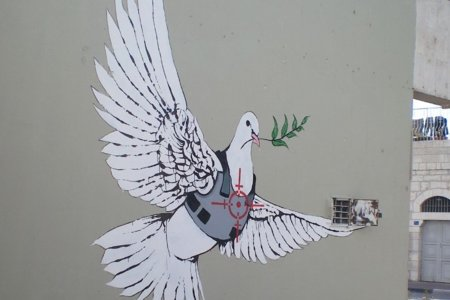 Banksy_Armoured Peace Dove by eddiedangerous with CC licence from flickr https://www.flickr.com/photos/eddiedangerous/2131727813/in/photolist-atjk9Z-j2Ao4-iyNxU-iYZum-4HVMhQ-4HVNo5-4JwaGU-4JwaLd-6hrKzm-4JU3Ji-6xsQDt-nDCMBr-pB4W4A-4fnEpP-btVY6g-4K1x2K-8Yn7sg-4LnWtR-qgvzhb-4HVN5Y-4JJ7AW-j7mmEF-4JDRBz-7otTRV-4HVNu9-egbCom-gp2USQ-9GyXD6-dcaeVN-65DExN-4JwaYs-nDC55m-kx3AU-j4pNa-4L3F3W-4KJSHh-4frDr1-5RL6ZC-qxTCHF-ig3cm-cRjF3J-4LnVU4-4Kh93F-qgsFvN-4Kmqdf-7t44k3-gp2sp7-gp2Qfv-qgBRKD-4Kh9gF